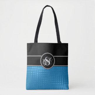La bolsa de asas azul del monograma de Aspen