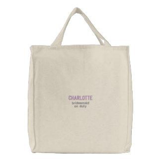La bolsa de asas bordada púrpura de servicio de la
