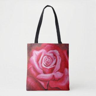 La bolsa de asas color de rosa