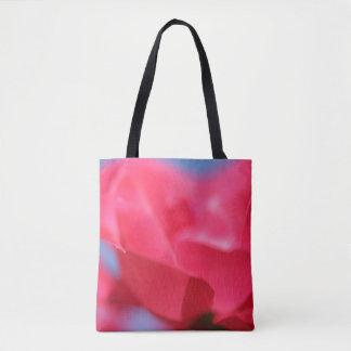La bolsa de asas color de rosa y del cielo rosada