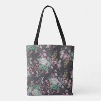 La bolsa de asas colorida de la flor