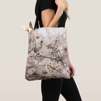 La bolsa de asas con la impresión de la flor de