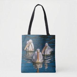 La bolsa de asas de la impresión de tres pelícanos