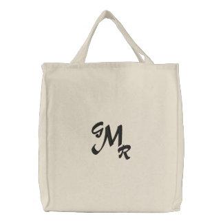 La bolsa de asas de la letra del monograma tres
