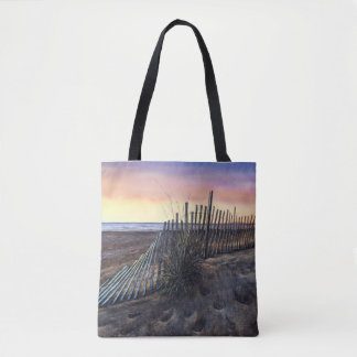 La bolsa de asas de la playa de la puesta del sol