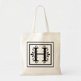 La bolsa de asas del monograma de la letra H