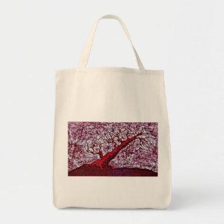 La bolsa de asas del ultramarinos con el árbol