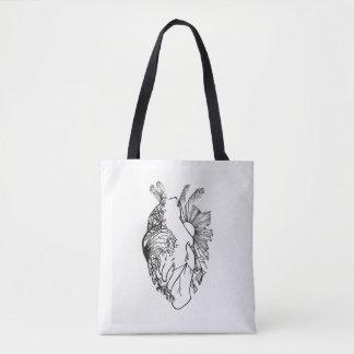 La bolsa de asas en forma de corazón del arte de