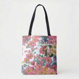 la bolsa de asas hermosa colorida de la flor