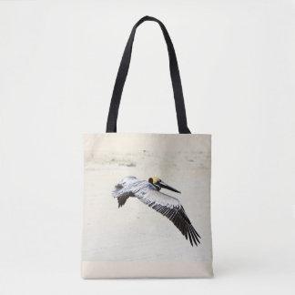 La bolsa de asas impresa pelícano