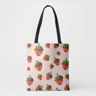 La bolsa de asas linda de la fresa