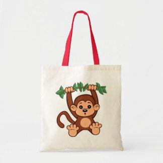 La bolsa de asas linda del mono del dibujo animado