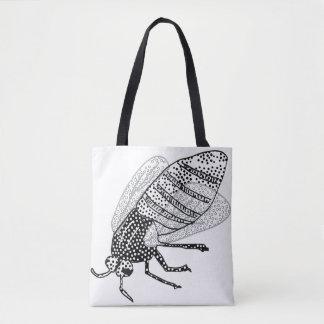 La bolsa de asas manchada de la mosca