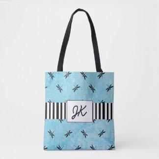 La bolsa de asas negra y azul de la libélula con