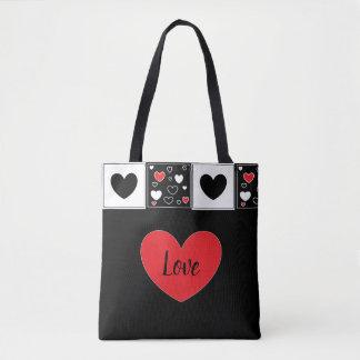 La bolsa de asas roja, blanco y negro del amor de