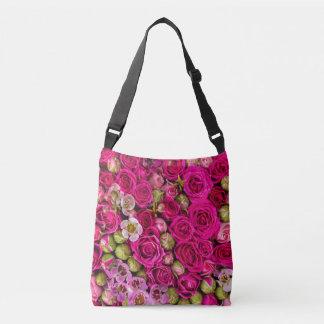 La bolsa de asas rosada bonita de la flor