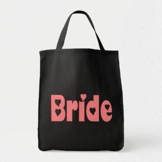La bolsa de asas rosada del boda del corazón de la