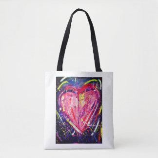 La bolsa de asas rosada del corazón de la