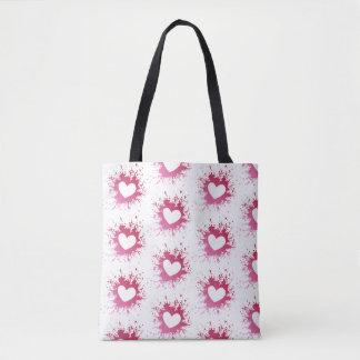 La bolsa de asas rosada linda de los corazones