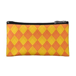 La bolsa de cosmético con modelo de rombo en tonos