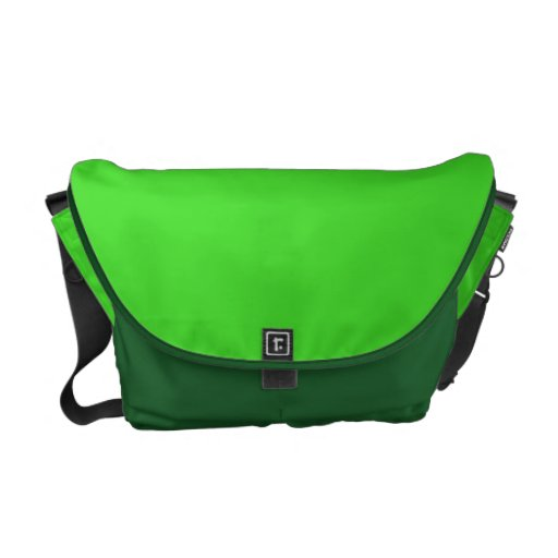 La bolsa de mensajero verde del carrito bolsas de mensajería