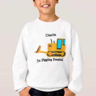 La camisa del niño de la niveladora