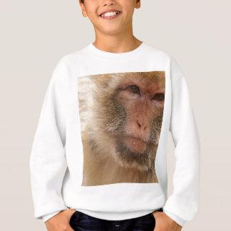 La camiseta del niño de la cara del mono