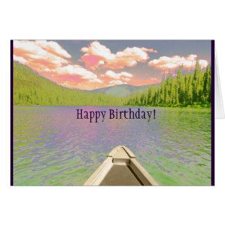 La canoa de la tarjeta de cumpleaños en el lago