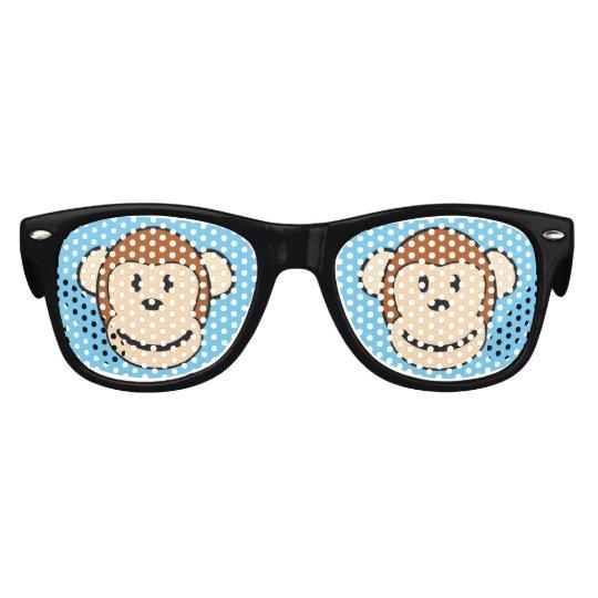 La cara del mono embroma las gafas de sol