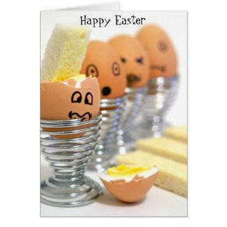 La cara divertida Eggs la tarjeta de pascua feliz