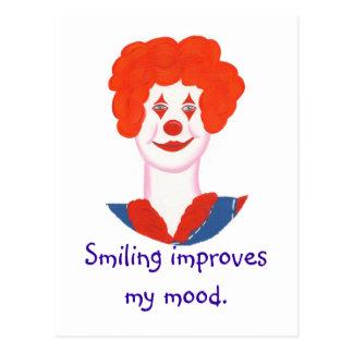 La cara feliz del payaso, sonriendo mejora mi humo postal