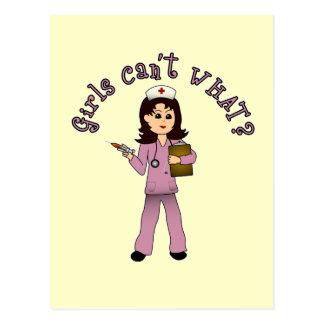 La enfermera en rosa friega (la luz) tarjetas postales