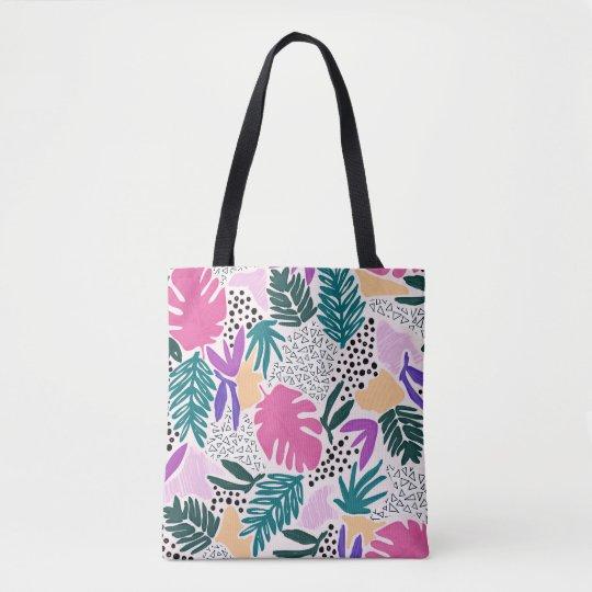 La flor colorida forma la bolsa de asas tropical