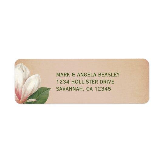 La flor de la magnolia meridional que casa la etiqueta de remite