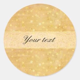 La hoja de oro personalizada protagoniza la pegatina redonda