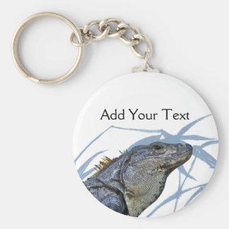 La iguana azul con el azul sale de llavero