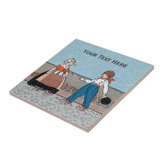 La madera holandesa de los niños del vintage calza azulejo cuadrado pequeño