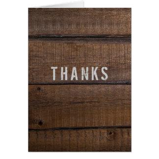 La madera oscura rústica le agradece de tarjeta