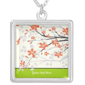 La magnolia anaranjada de la verde lima florece el colgante cuadrado