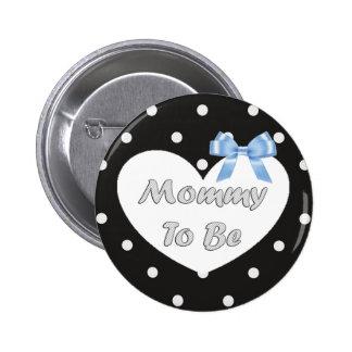 La mamá a ser polca azul y negra punteó el botón