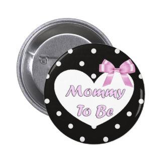 La mamá a ser polca rosada y negra punteó el botón