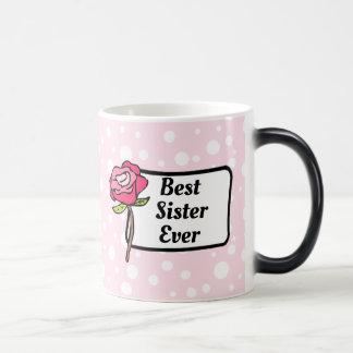 La mejor taza de café punteada del rosa de la