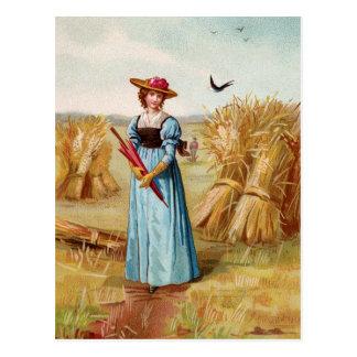La mujer en la postal del campo de trigo