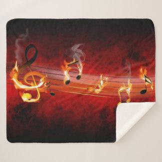 La música caliente observa la manta media del paño