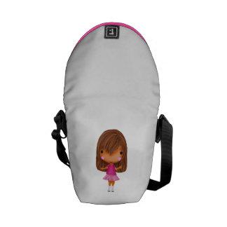 La niña en el vestido rosado bolsas de mensajeria