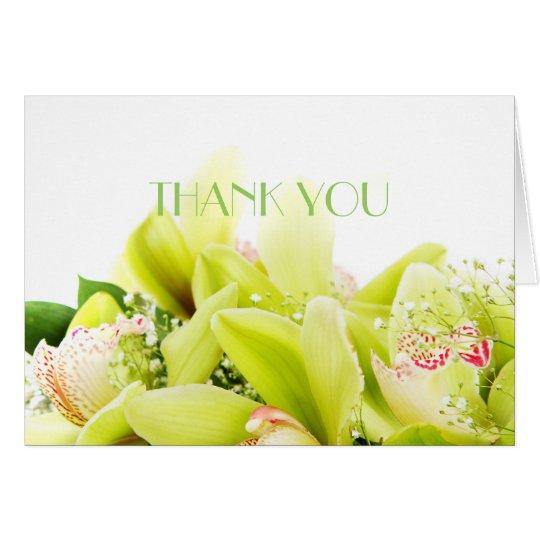 La orquídea romántica de la primavera le agradece tarjeta de felicitación