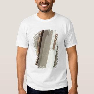 La paleta y una caja del escribano para escribir camiseta