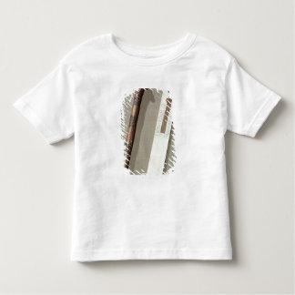 La paleta y una caja del escribano para escribir camiseta de bebé