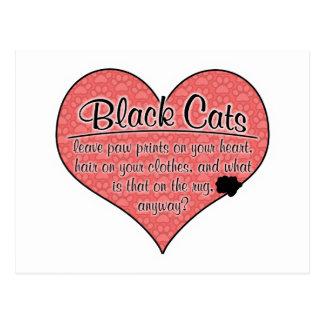 La pata del gato negro imprime humor postal