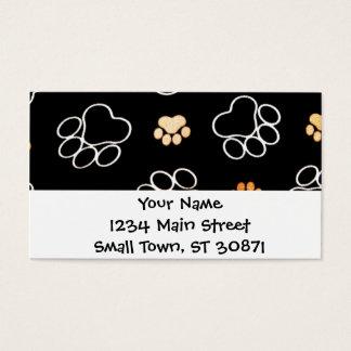 La pata del perrito del perro imprime negro y el tarjeta de negocios